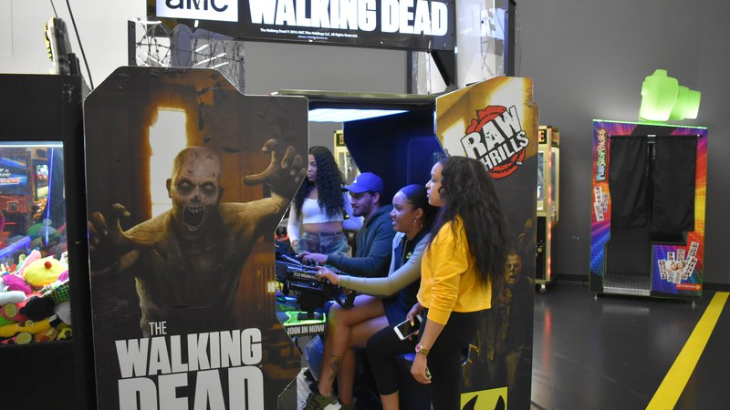 Girls playing Walking Dead Arcade Game