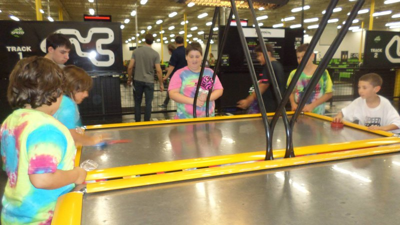 Kids playing Air Hockey Arcade Game| Family Fun Center