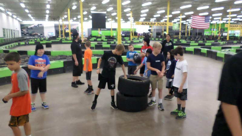 Kids playing on a go-kart track | Summer racing camp at Speed Raceway