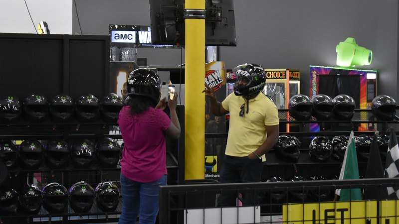 A couple taking picture at go-kart track | Speed Raceway entertainment center
